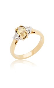 18ct oval cut yellow gold yellow diamond and heart diamond ring