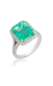 18ct white gold emerald ring with diamond surround and shank