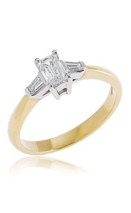 18ct Yellow gold emerald cut diamond ring with tapered baguette diamond shoulders