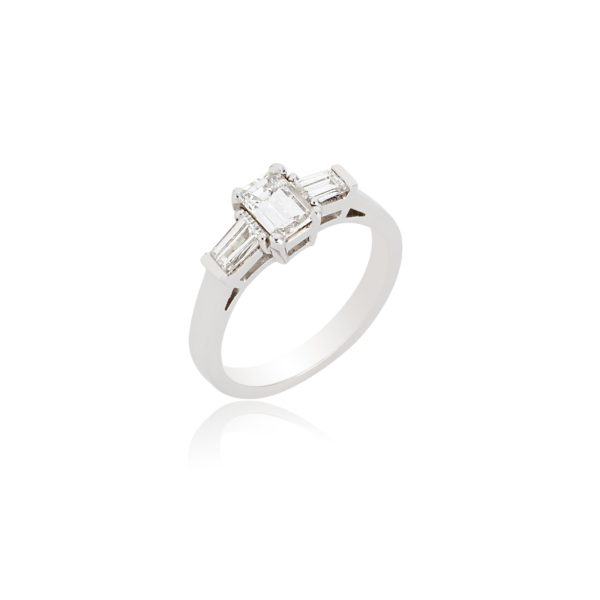Platinum Emerald cut diamond ring with tapered baguette shoulders