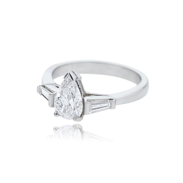 Platinum pear cut diamond ring with tapered baguette cut diamond