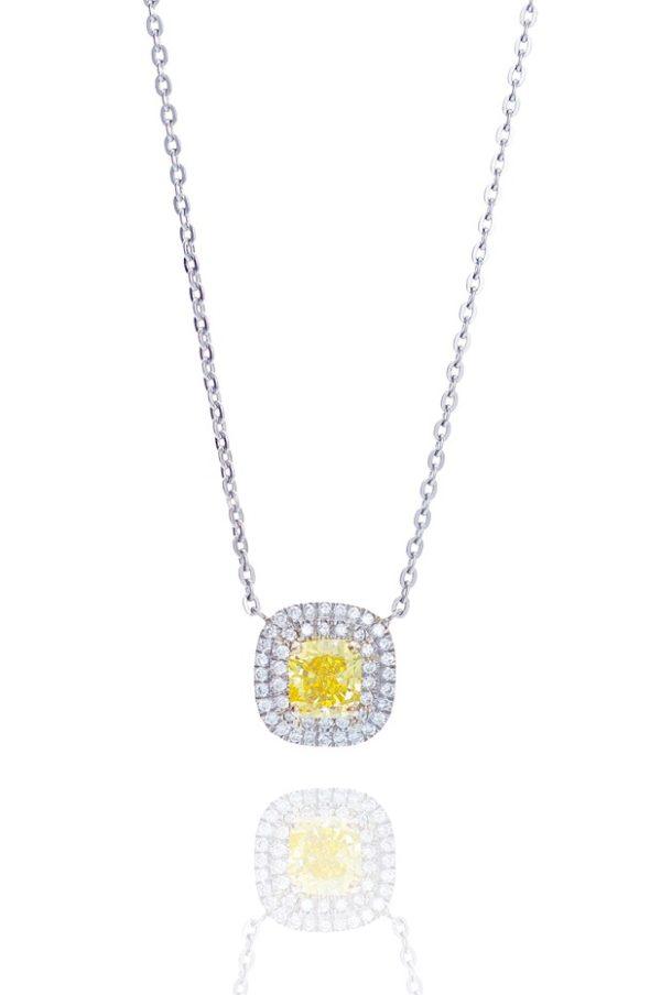 Platinum fanct vivid yellow diamond pendant.