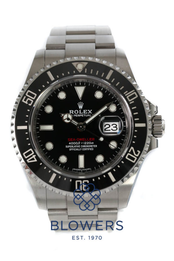 Black dial with index hour markers. 'SEA-DWELLER' in red writing